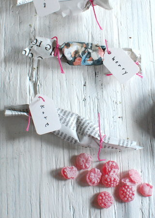 1367352669 content diy newspaper wrapped candy favors 5